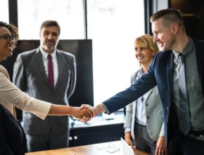 business, shaking hands, man and woman
