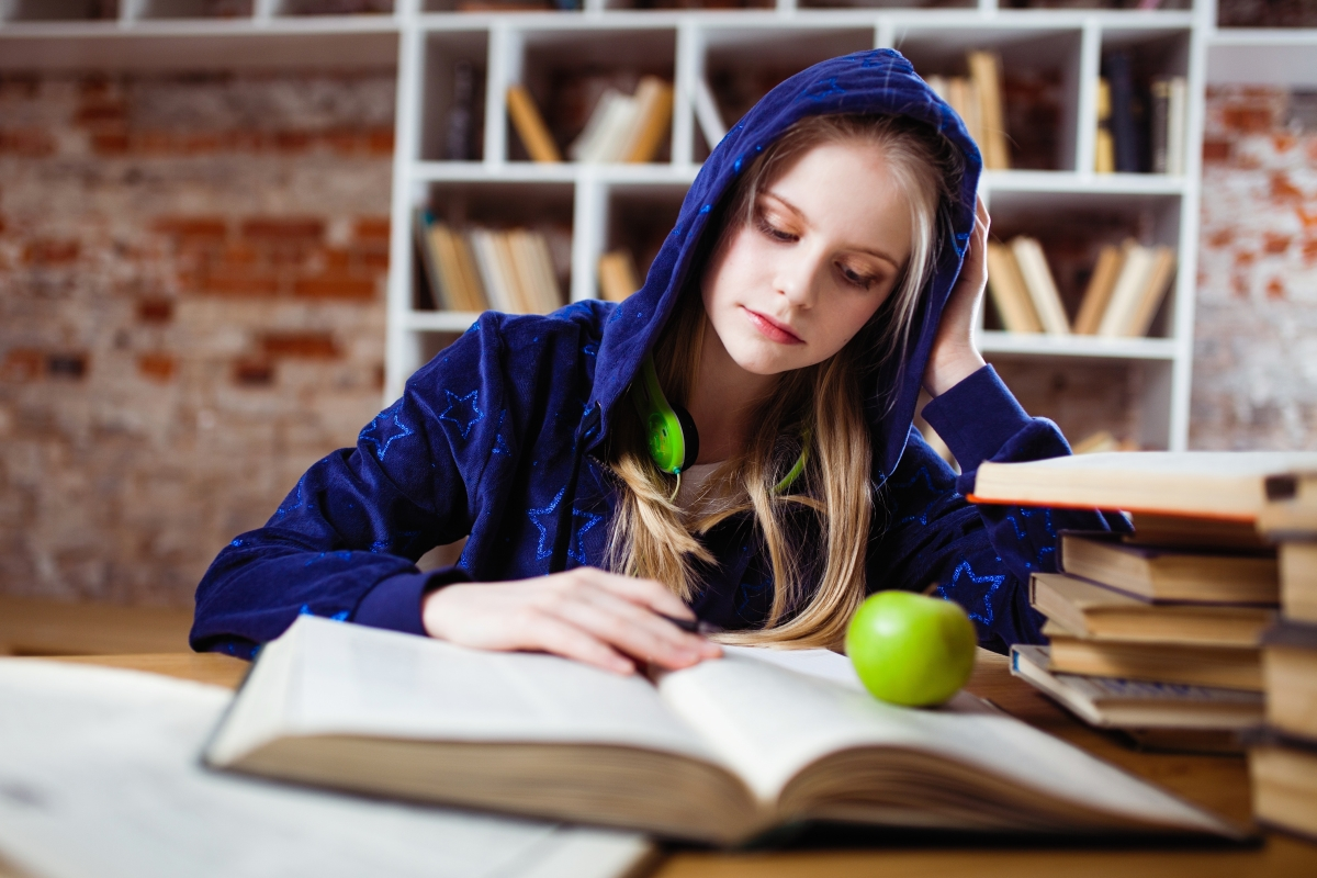 student studying, book, hoodie