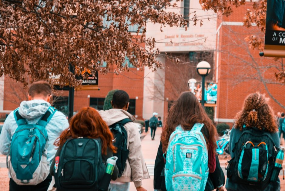college students walking with backpacks