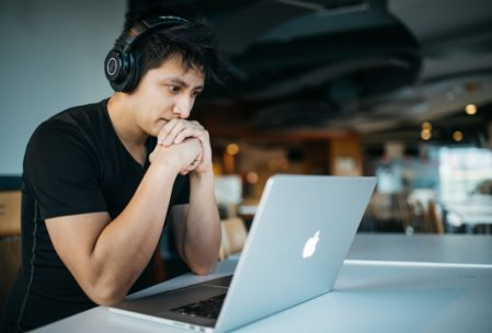 man with headphones and laptop